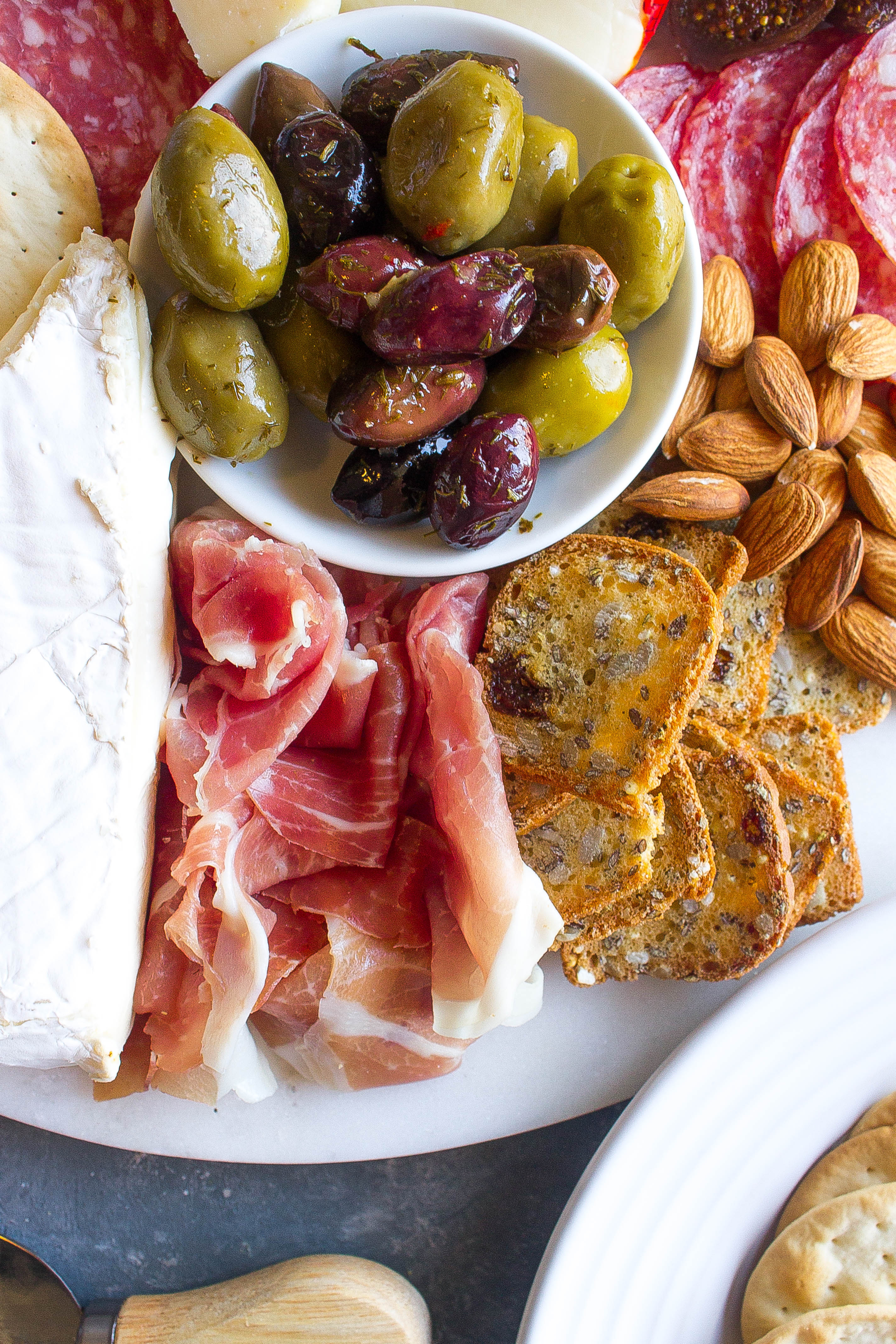 Cheese plate with prosciutto and olives