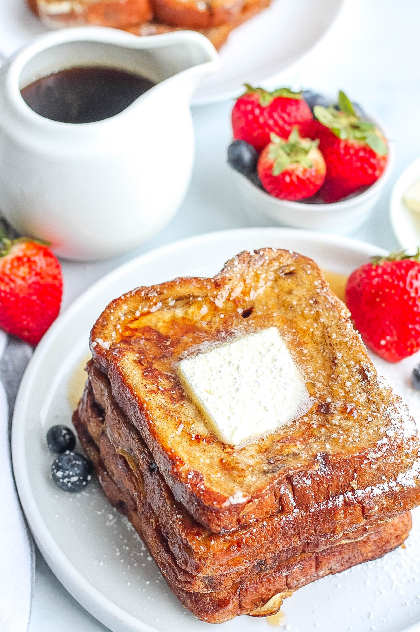 homemade cinnamon french toast with berries and butter
