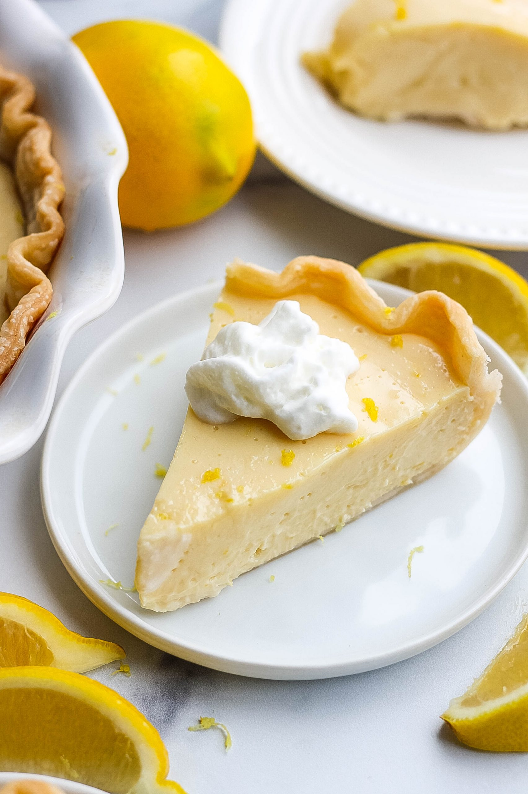 slice of lemon pie with zest and whipped cream