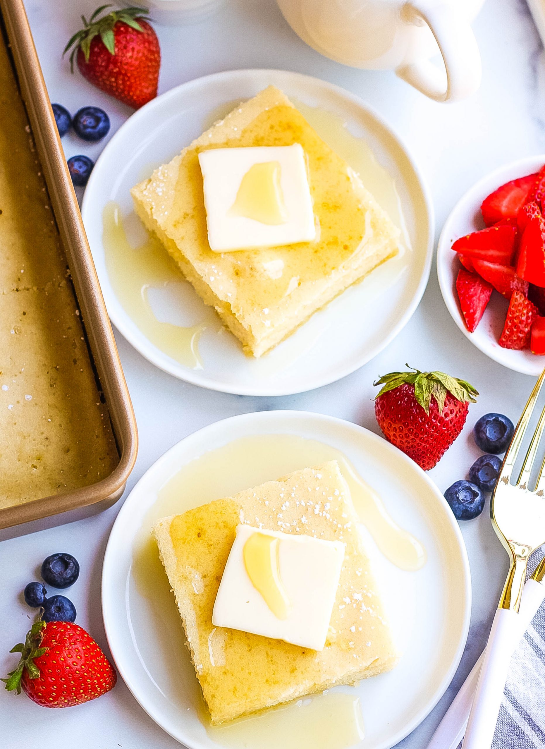 fluffy baked pancakes with butter and maple syrup