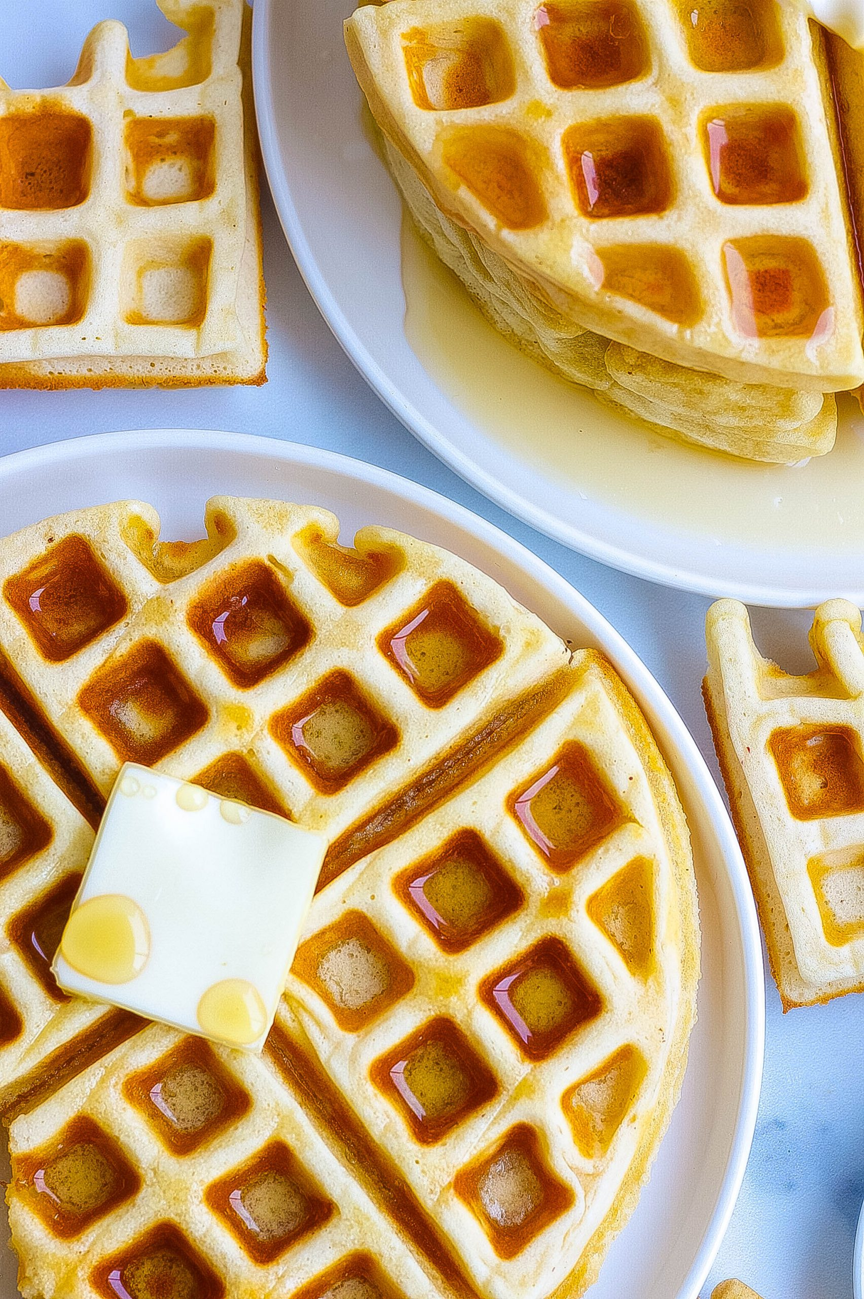 homemade buttermilk waffles with butter and syrup
