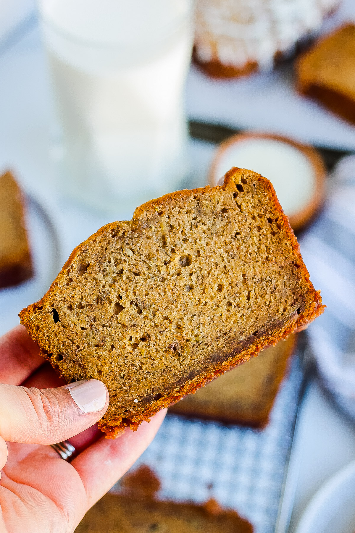 one hand holding cinnamon banana bread slice
