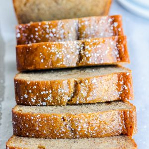 close view of sliced cinnamon banana bread slices with powdered sugar