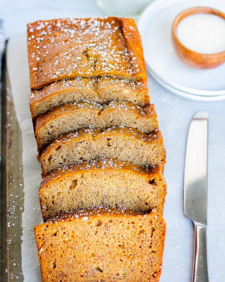 sliced banana bread with cinnamon and sugar with butter knife