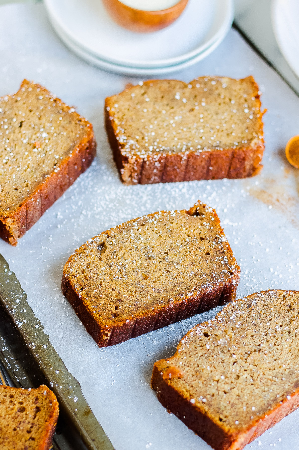 four slices of cinnamon banana bread on parchment paper